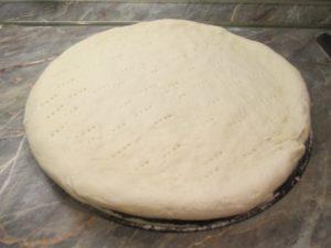 Pizza sütésre előkészítve